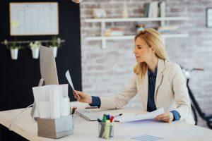 businesswoman-working-in-her-office--638761554-5c509c334cedfd0001ddb6d3