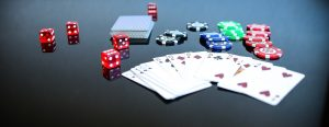 texas holdem poker game with cards and dice
