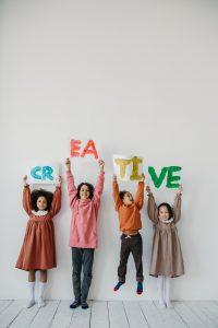 children holding creative sign