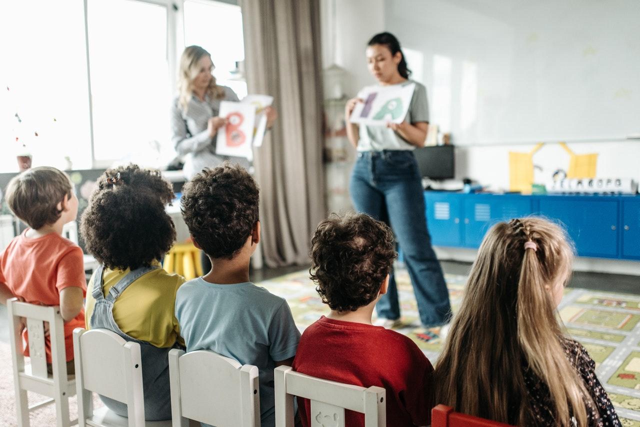 teachers and students in montessori school